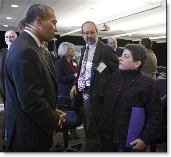 Loren Sure expressing her interests in STEM education to Governor Patrick